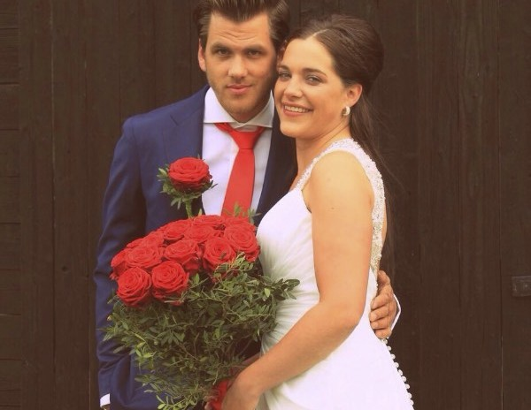 Newly weds with Porta Nova Red Noami bridal bouquet